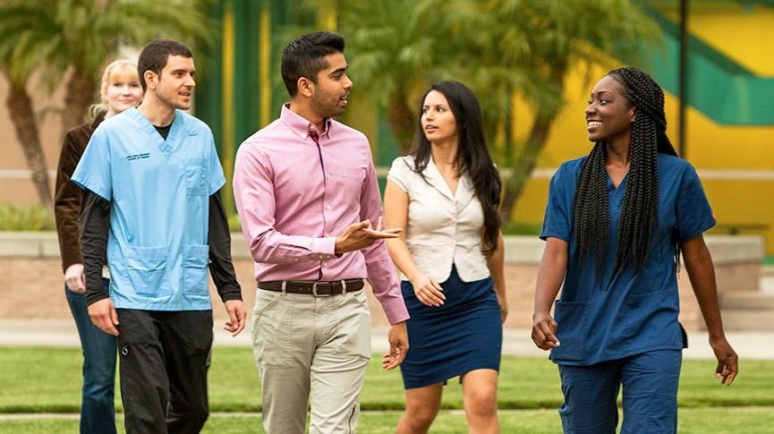 diverse group of loma linda university students walking together outside