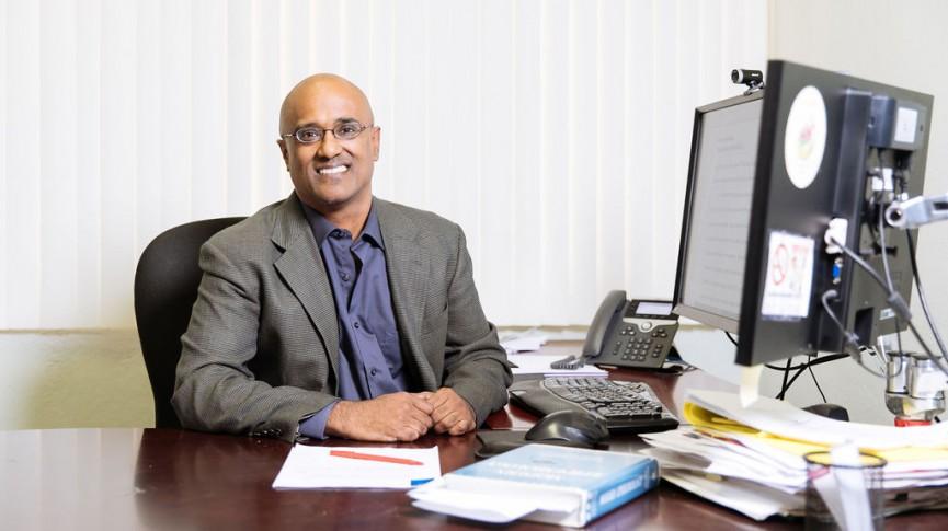 photo of pramil singh at his desk